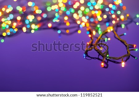 Christmas lights on dark blue background with copy space. Decorative garland - stock photo