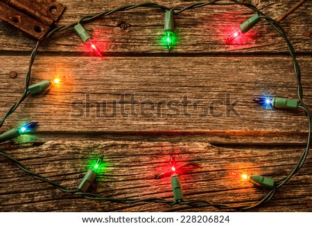 Christmas Lights On Old Rustic Wood Background
