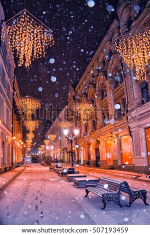 Christmas lights on the streets of Moscow, snowy winter night