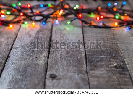 Christmas lights on wooden background, abstract template with selective focus - stock photo