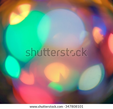 Christmas lights out of focus. Defocused colorful xmas light wallpaper - stock photo