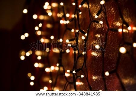 Christmas lights over dark background - stock photo