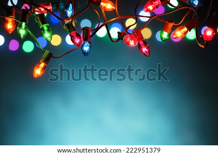 Christmas lights over dark blue background - stock photo