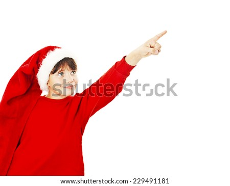 Christmas little girl pointing at copy space. Isolated on white background  - stock photo