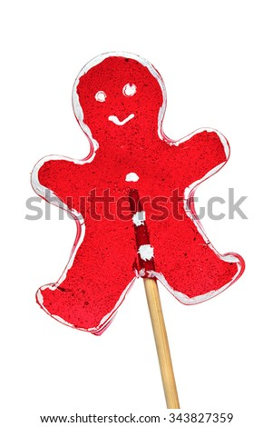 Christmas lollipop in shape of a red man isolated over white - stock photo