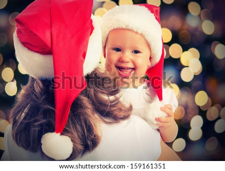 Christmas magic  a woman happy family mother and Child baby - stock photo