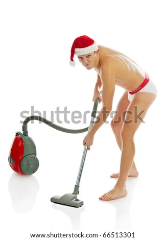 Christmas man with vacuum cleaner. Isolated over white background
