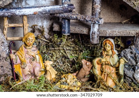 Christmas manger scene with figurines including Jesus Mmary Joseph - stock photo