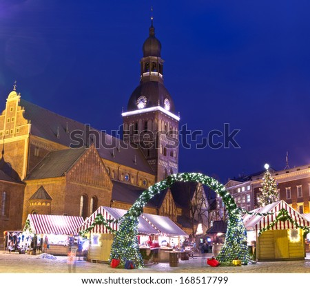 Christmas market near Riga Cathedral in old city of Riga, Latvia - stock photo