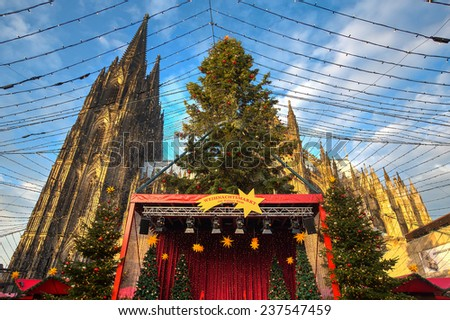 Christmas market near the Dom church in Cologne Germany in the evening sun - stock photo