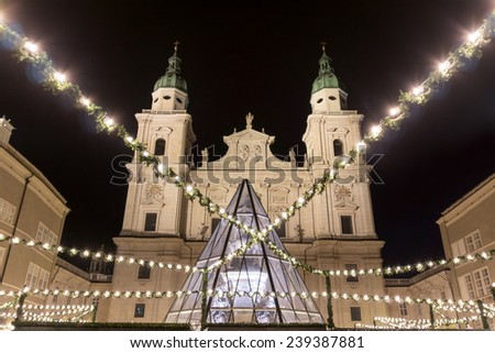 christmas market with the salzburger cathedral - stock photo