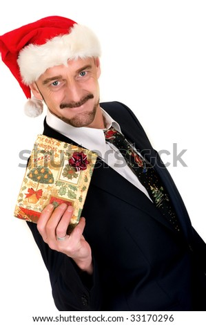Christmas, middle aged businessman with present, gift.  studio shot, white background - stock photo