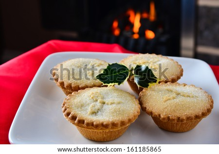 Christmas mince pies by the fire - stock photo