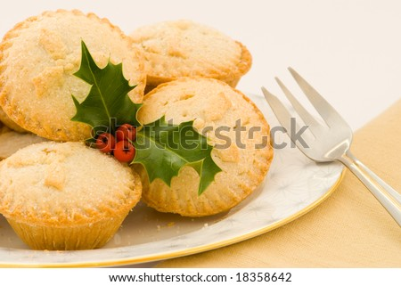 Christmas mince pies on a plate - stock photo