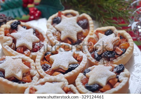 Christmas mince pies on a white plate - stock photo