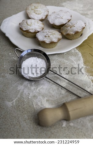 Christmas mince pies on the white plate - stock photo