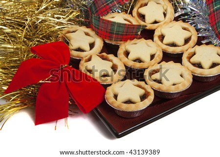 Christmas mince pies with tinsel and red bow - stock photo