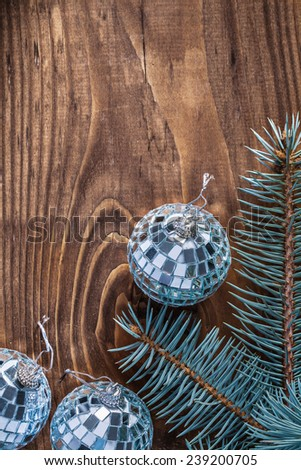 christmas mirror disco balls and branch of pinetree on old wooden board with copyspace vertical version - stock photo