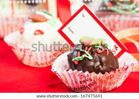 christmas moist cake balls covered with milk or white chocolate - stock photo