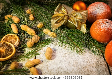 christmas mood on a table with fruits and candy - stock photo