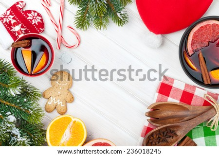 Christmas mulled wine and fir tree on wooden table. View from above with copy space