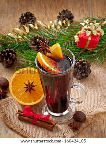 Christmas mulled wine in glass cup on a wooden table - stock photo