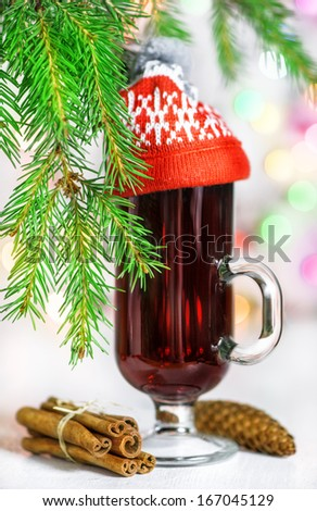 Christmas mulled wine in the glass with red hat  - stock photo