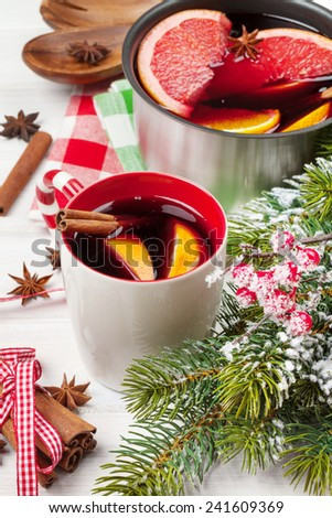 Christmas mulled wine on wooden table closeup