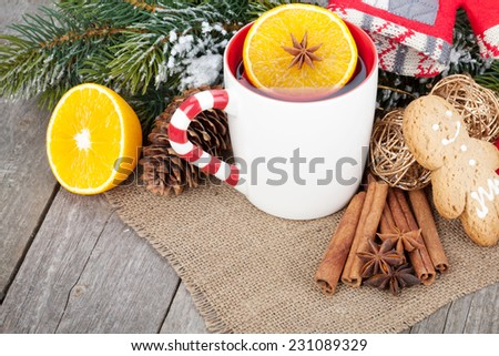 Christmas mulled wine with fir tree and decor on wooden table - stock photo
