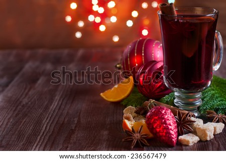 Christmas mulled wine with spices and orange. Selective focus. Copyspace background. - stock photo