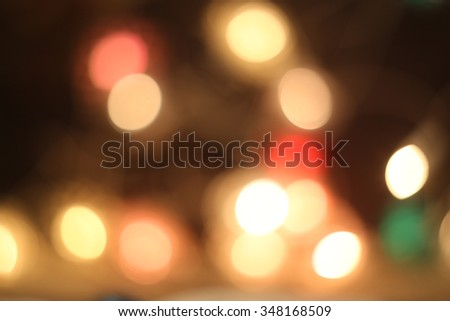 Christmas multicolored bokeh lights background. New Year celebration.