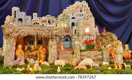 Christmas Nativity Scene - Baby Jesus, Mary, Joseph & Shepherds. - stock photo