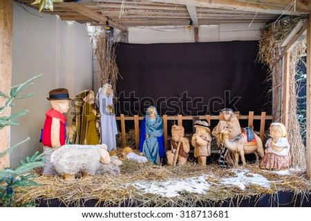 christmas nativity scene of jesus birth in an old cottage nearby bethlehem with joseph, mary and shepherd - stock photo