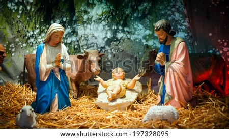 Christmas nativity scene with baby Jesus, Mary & Joseph in barn - stock photo