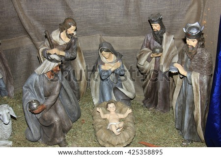 Christmas nativity scene with baby Jesus, Mary & Joseph in barn - stock photo