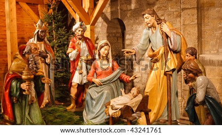 Christmas Nativity Scene with Three Wise Men Presenting Gifts to Baby Jesus, Mary & Joseph. - stock photo
