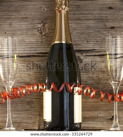 Christmas, New Year, Celebration, Champagne in a glass bottle, two glasses of wine, Top view, closeup, Background. - stock photo
