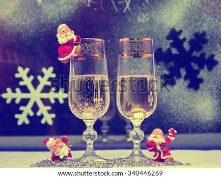 Christmas; New year, wine glasses with champagne and toys gnomes, vintage, retro, old style picture, photo in old style, - stock photo