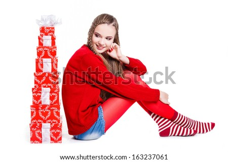 christmas, new year, winter concept - smiling woman with many gift boxes. Smiling happy girl on white background. - stock photo