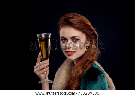 christmas, new year, young woman with a glass of champagne