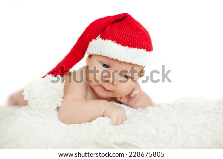 Christmas newborn baby in santa hat. Winter child on winter white background - stock photo