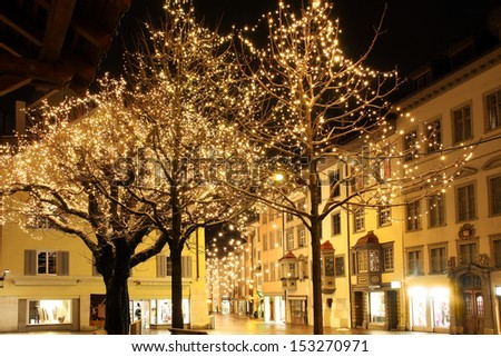 Christmas night in an old European town - stock photo