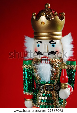 Christmas nutcracker against red background
