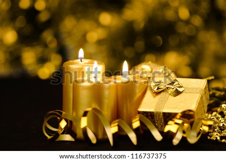 Christmas objects of decoration. Candles, ribbons, gifts - stock photo