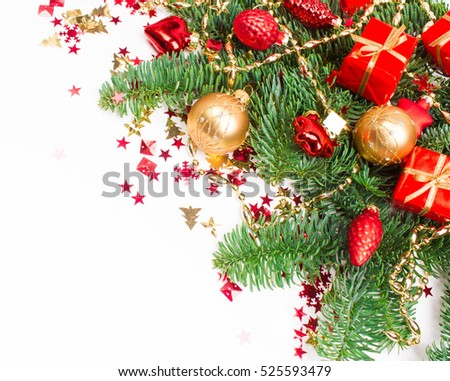 Christmas or New Year background: fur-tree, branches, colored glass balls and toys, gifts, decoration on a white background