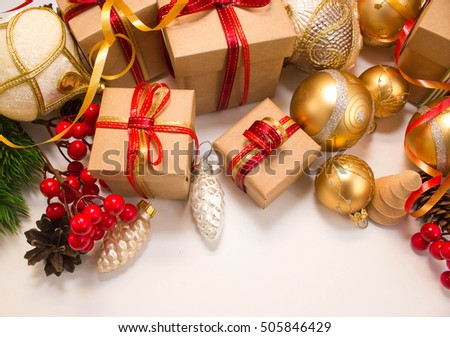 Christmas or New Year background: fur-tree, branches, gifts, colored glass balls, decoration and cones on a white background