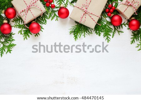 Christmas or New Year background, plain composition made of Xmas decorations and fir branches, flat lay, blank space for a greeting text