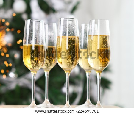 Christmas or New Year Celebration. Champagne near the Christmas tree - stock photo