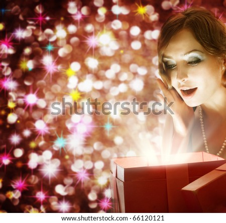Christmas or New Year Gift.Surprised Woman - stock photo