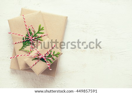 Christmas or New Year presents on a wooden natural warm white surface, view from above, retro stylized photo   - stock photo